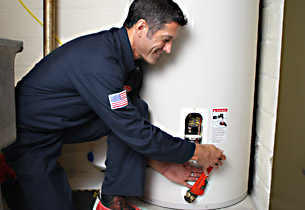 Mark is making a small repair on a conventional water heater